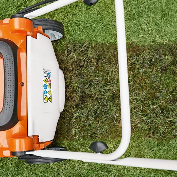 What is a lawn scarifier and how do I use it?